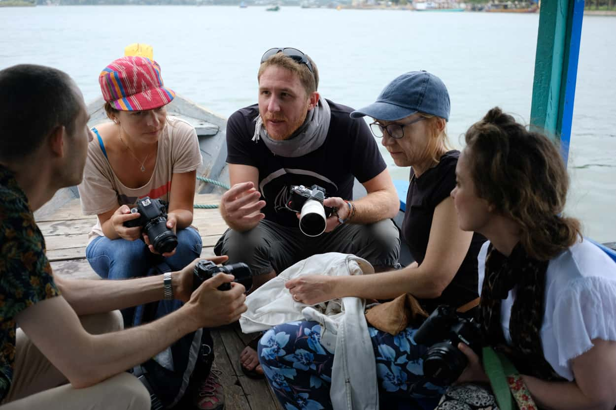 a group of students gather around for hands on teaching with Hoi An Photo Tours