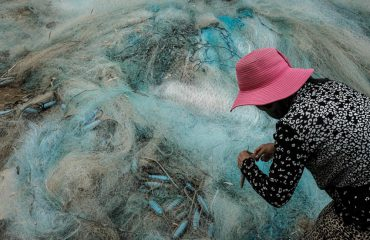Portrait Of A Woman Fixing Fishing Nets Vietnam