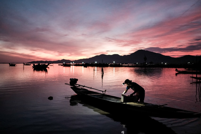 A fisherman bring his catch at sunrise in a lagoon of central Vietnam during Pics of Asia photography tour