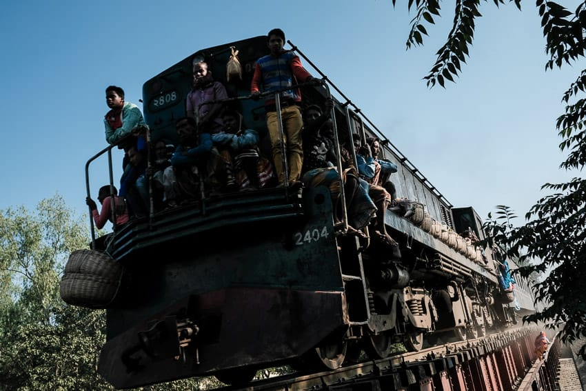 Groups of people riding the train in Bangladesh during a photography tour with Pics of Asia