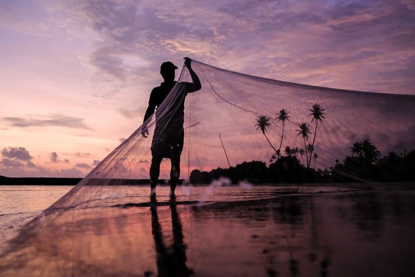 Capturing fishermen activity at sunset during a photography tour in Sri Lanka by Pics of Asia