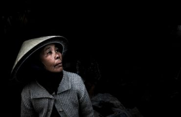 Colour Portrait Of Vietnamese Woman In Shadow