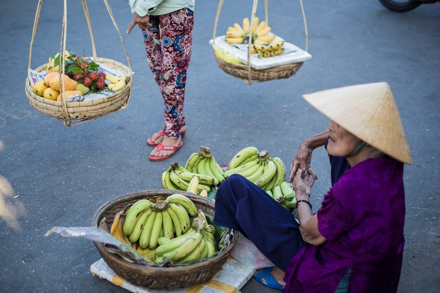 Street Photography - Two Women Sell Bananas In Baskets On The Streets Of Hoi An
