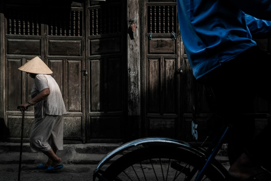 A local woman walks in hoi an old town during hoi an photo tour and workshop