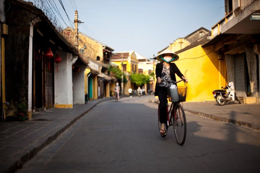 Woman riding her bicycle in hoi an old town taken during hoi an morning photo walk
