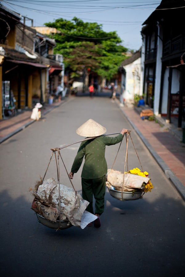Street Photography - A woman uses a traditional method to carry goods to market