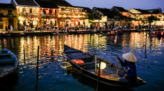 Woman on a boat on the river in Hoi An old town at night