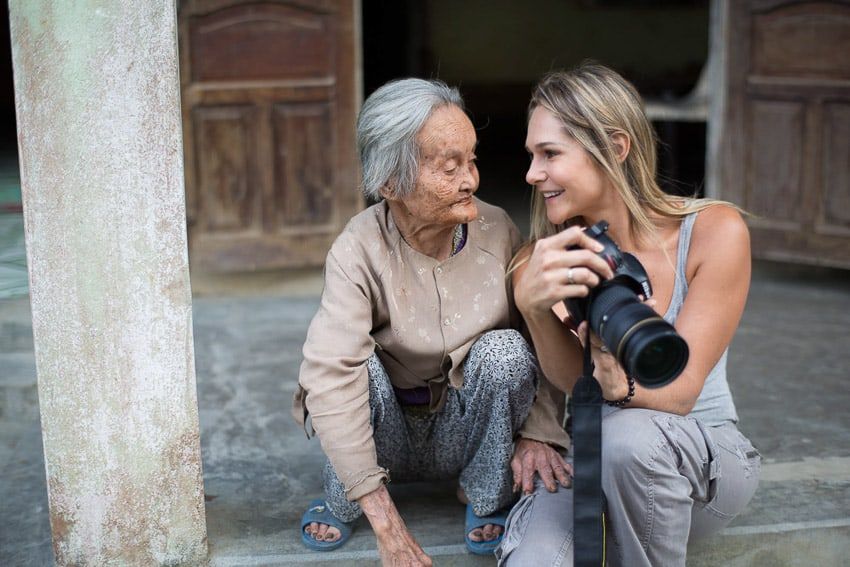 talking with the locals on hoi an photo tour