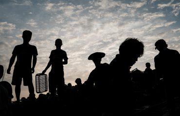 silhouette photo of Vietnamese fishermen