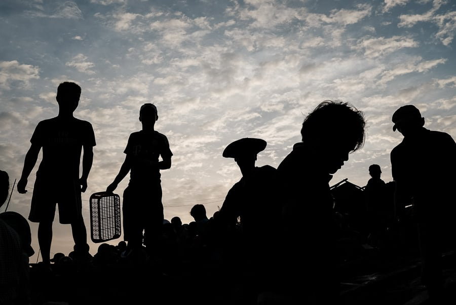 Vietnamese fishermen photographed as silhouettes in Hoi an during our sunrise photography tour and workshop