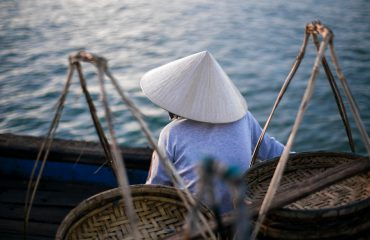 Sunrise Tour Hoi An - A Woman In Her Boat Morning