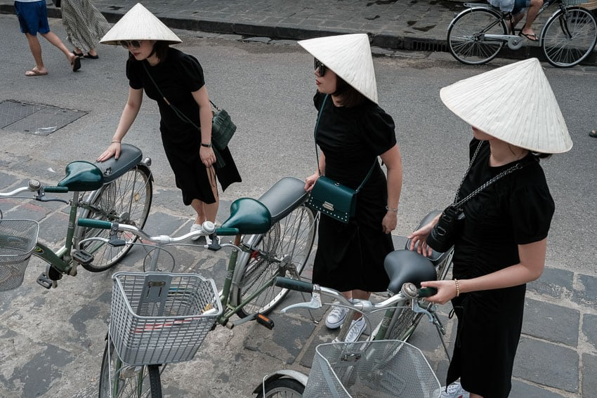 Three Chinese Tourists Explore With Hoi An Photo Tours In Matching Outfits