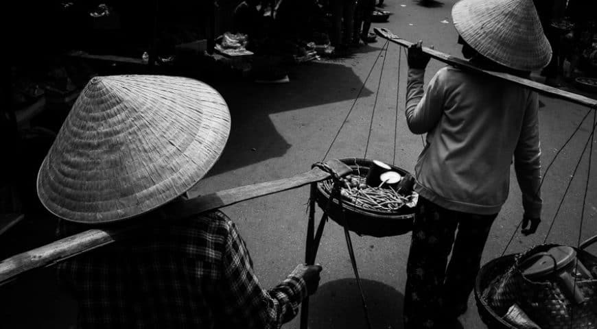 local women walking through hoi an market