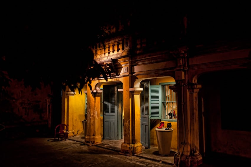 Light frames a shoe store in old town Hoi An during a Hoi An Photo Tour