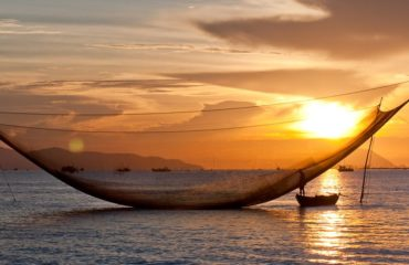 fishing net in hoi an at sunrise