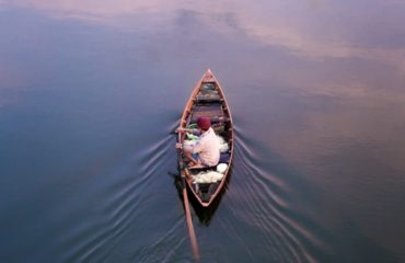 boat on hoi an river at sunrise