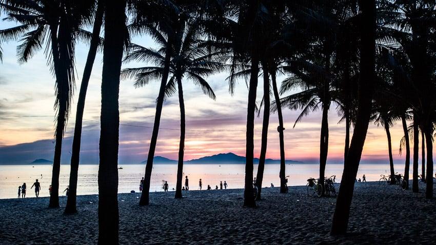 taking landscape photos of the sunrise on cua dai beach with hoi an photo tour