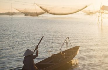 fishing boat and fishing net at sunrise in Hoi An