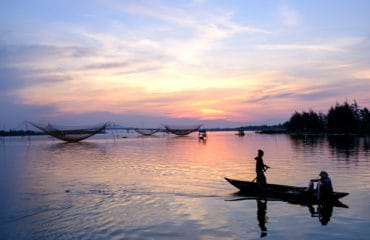Fishermen at sunrise in hoi an, Vietnam