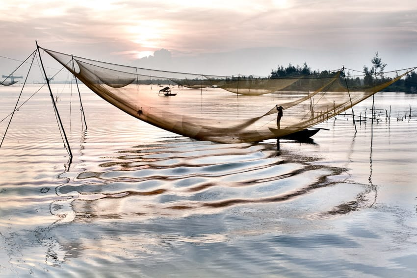 Capture amazing photos of the fishing nets at sunrise around Hoi An with Hoi An photo tour and workshop