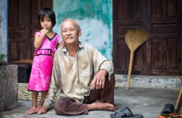 Grandfather and granddaughter in the countryside around Hoi An