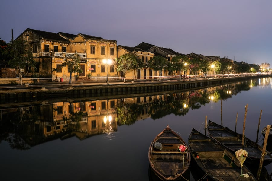 a photo of hoi an old town from the walking bridge at sunrise
